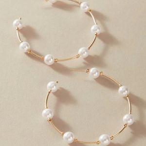 Gold faux pearl hoop earrings.